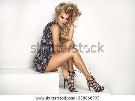 Sexy elegant woman posing in dress - stock photo