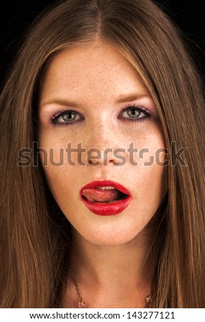 sexy fashion girl with red lipstick lick her lips with tongue - stock photo