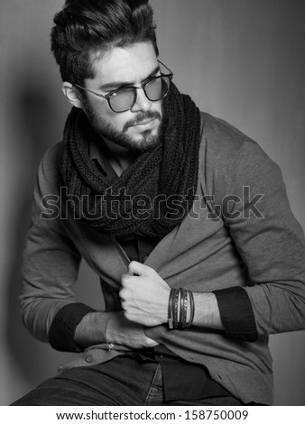 sexy fashion man model dressed casual posing dramatic in the studio