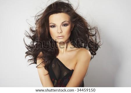 sexy fashion model posing on light background - stock photo