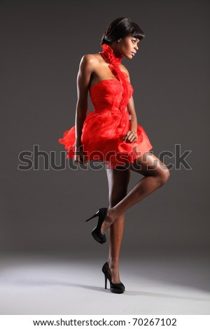 Sexy fashion model wearing short red dress - stock photo