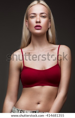 sexy  fashion model with long hair, young European attractive, beautiful eyes, full lips, perfect skin is posing in studio for glamour vogue test photo shoot showing different poses - stock photo