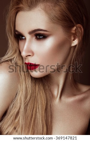 sexy fashion model with long hair, young European attractive, beautiful eyes, red lips, perfect skin is posing in studio for glamour vogue test photo shoot showing different poses.  - stock photo