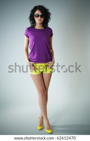 Sexy fashion model with long legs posing - stock photo