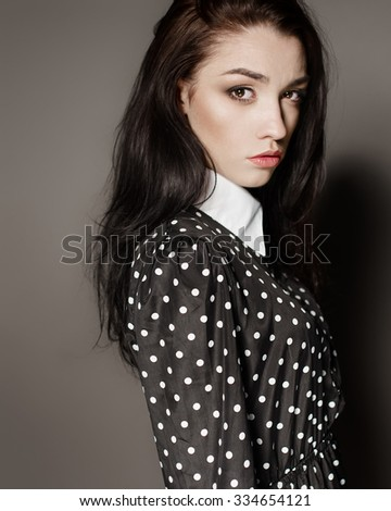 sexy fashion portrait of a beautiful girl in the studio closeup