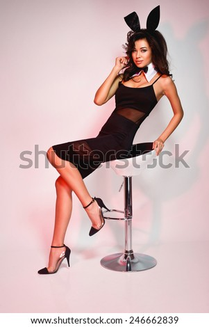 Sexy fashion woman posing in bunny ears. Playboy style - stock photo