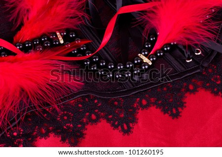 Sexy fashionable beads and black laces on background. - stock photo