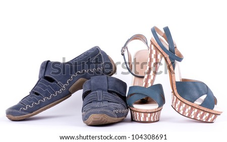 Sexy fashionable man's and womanish shoes on white background. - stock photo