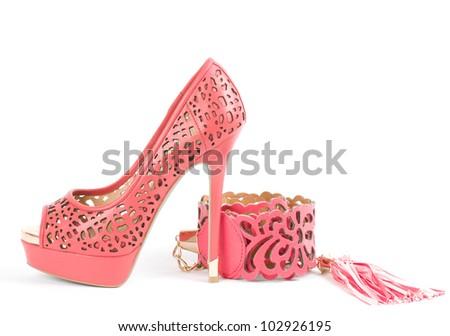 Sexy fashionable shoe and belt isolated on white background. - stock photo