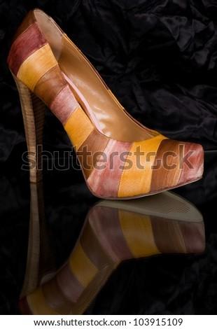 Sexy fashionable shoe on black background. - stock photo