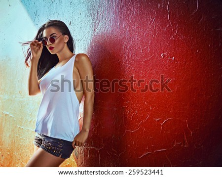 Sexy fashionable woman on red background - stock photo