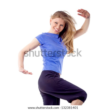 Sexy female aerobics/fitness trainer in dancing pose. Active, happy and joyful girl with flowing hair and arms raised.  Isolated on white background - stock photo