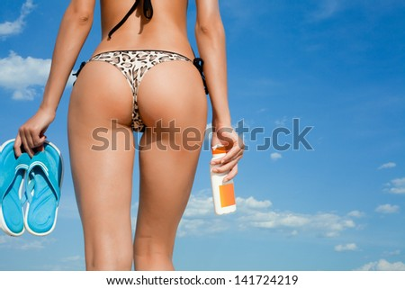 Sexy female back on the beach - stock photo