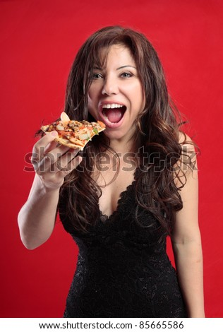 Sexy female eating a slice of delicious pizza - stock photo