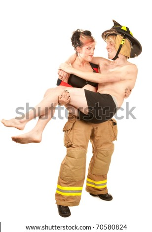 Sexy female firefighter rescuing a grateful handsome man