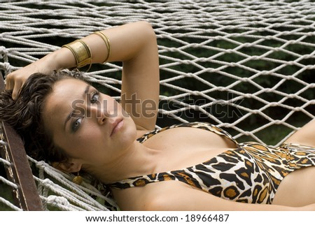 Sexy female in bathing suit looking at camera on a sunny day - stock photo