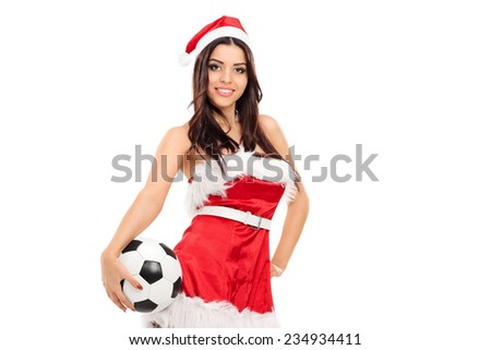 Sexy female in Santa costume holding a football isolated on white background - stock photo