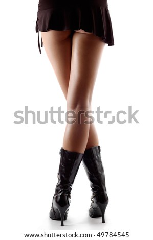 Sexy female legs in boots isolated on white