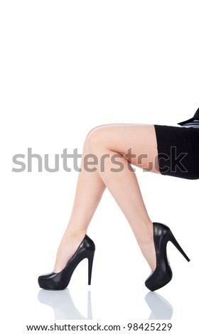 sexy female legs in classical shoes on a heel isolated over white background