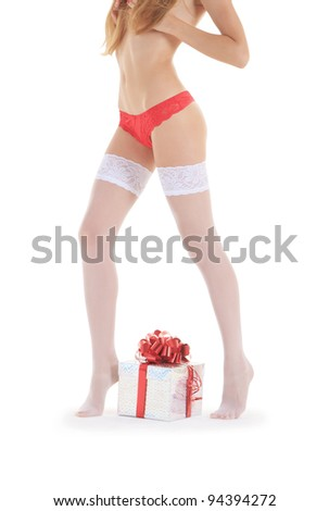 sexy female legs in white stockings with gift