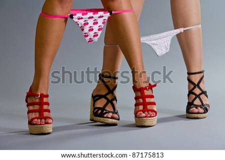 Sexy female model legs with panties down - stock photo