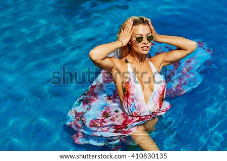 Sexy female model posing in the pool - stock photo