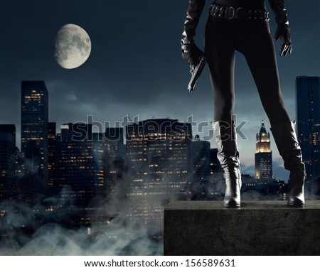 Sexy Female thief with gun, new york on background - stock photo