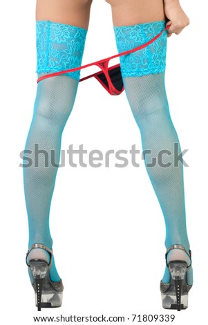Sexy female wearing blue fishnet stockings taking off her red panties, over white background - stock photo