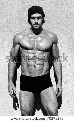 Sexy fine art black and white portrait of a very muscular shirtless maile model posing - stock photo