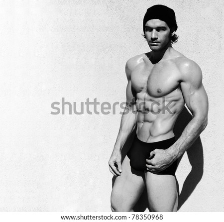 Sexy fine art black and white portrait of a very muscular shirtless male model - stock photo