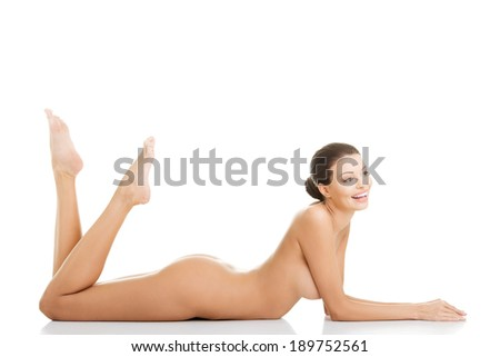 Sexy fit naked woman with healthy clean skin lying down, isolated on white  - stock photo