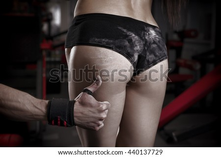 Sexy fitness ass close-up. Perfect female muscular buttocks - stock photo