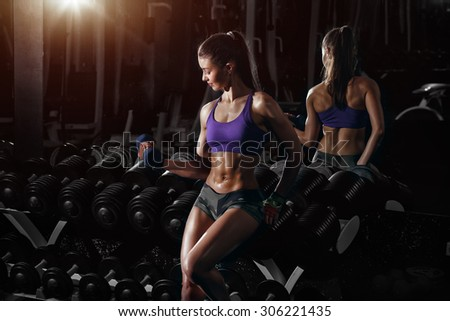 Sexy fitness brunette doing exercises in the sport gym  - stock photo