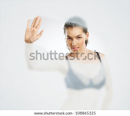 sexy girl clean the glass - stock photo