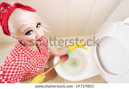 Sexy girl cleaning toilet, similar available in my portfolio - stock photo