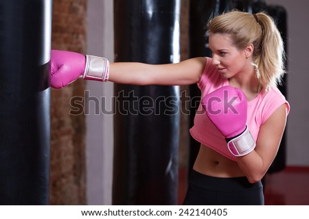 Sexy girl during boxing at the gym - stock photo