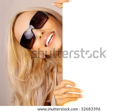 Sexy girl holding a blank billboard - stock photo