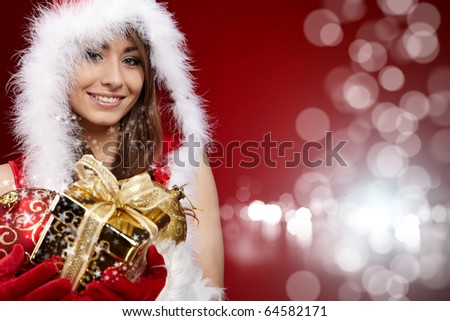 sexy girl holding a gift in packing