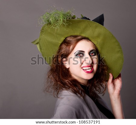 sexy girl in a witch's vampire makeup,  halloween party, halloween costume, halloween witch, woman Halloween, scary halloween, spooky halloween image, vampire woman - stock photo
