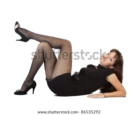Sexy  girl in black dress lying  over white background