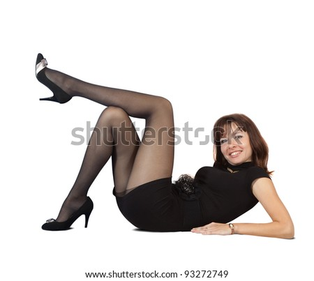 Sexy  girl in black dress lying  over white background - stock photo