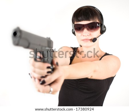 Sexy girl in black dress with pistol and headphones. - stock photo