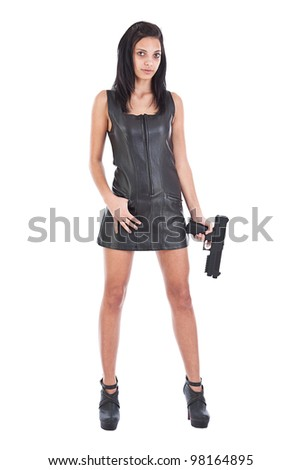 Sexy girl in black leather with gun - stock photo