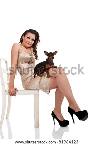 sexy girl in dress with her puppy, isolated on white background - stock photo