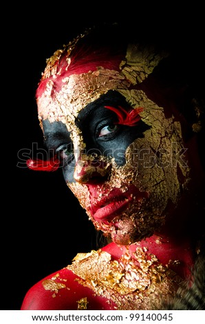 Sexy girl in fantasy demon makeup - stock photo