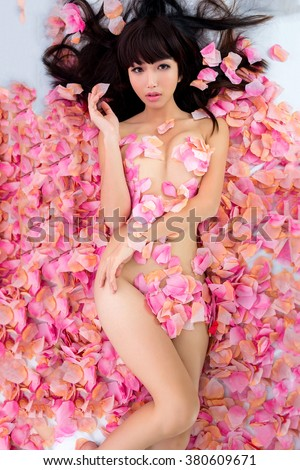 sexy Girl in flower spa - stock photo