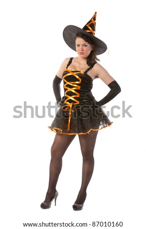 sexy girl in Halloween witch costume - stock photo