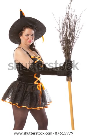 sexy girl in Halloween witch with broom - stock photo