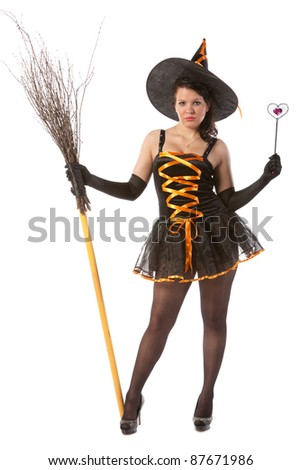 sexy girl in Halloween witch with broom and wand - stock photo
