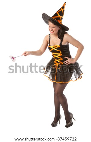 sexy girl in Halloween witch with wand - stock photo